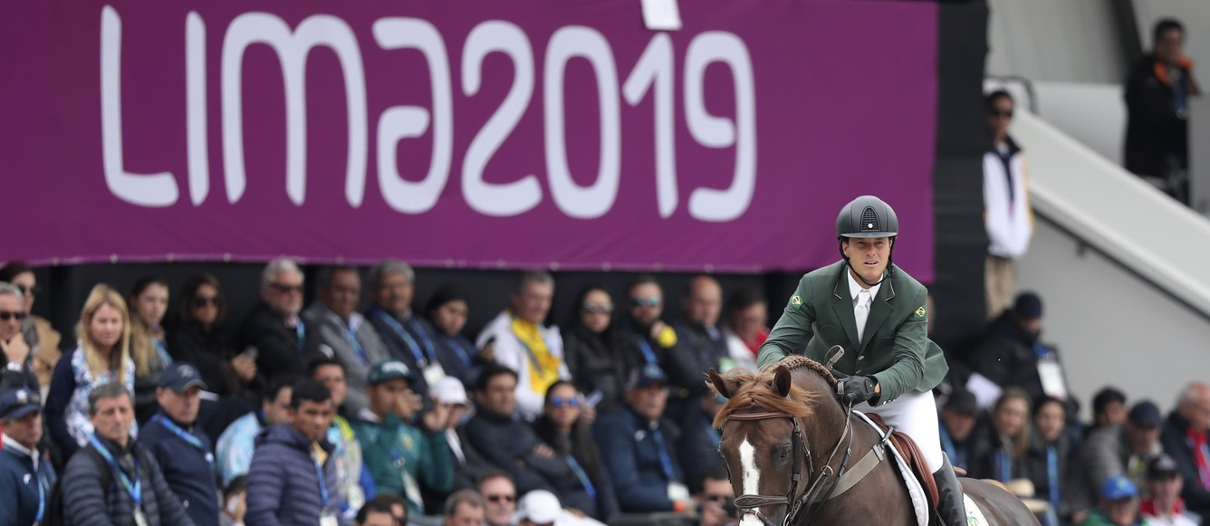 LIMA, PERU - AUGUST 07: Pedro Veniss of Brazil riding Quabri de L Isle competes during equestrian Jumping Team at Army Equestrian School on Day 12 of Lima 2019 Pan American Games on August 7, 2019 in Lima, Peru. (Photo by Raul Sifuentes/Getty Images for FEI)