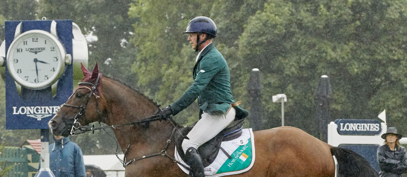 Anthony Condon IRL riding SFS Aristio in the lashings of rain wins the Longines FEI Nations Cup™ of Great Britain for Ireland at Hickstead GBRPhoto FEI/Liz Gregg